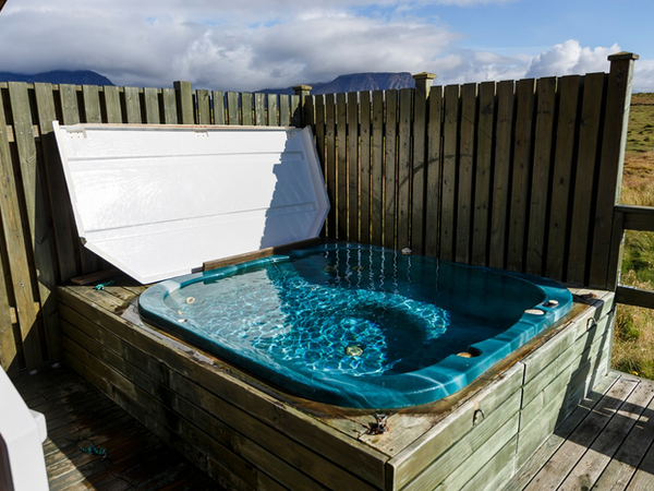 A hot tub sits outside every cabin at Snorrastaðir.
