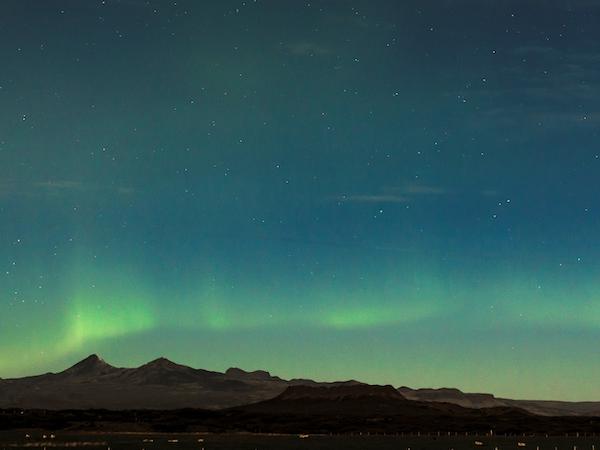 The aurora borealis dance over Snorrastaðir.