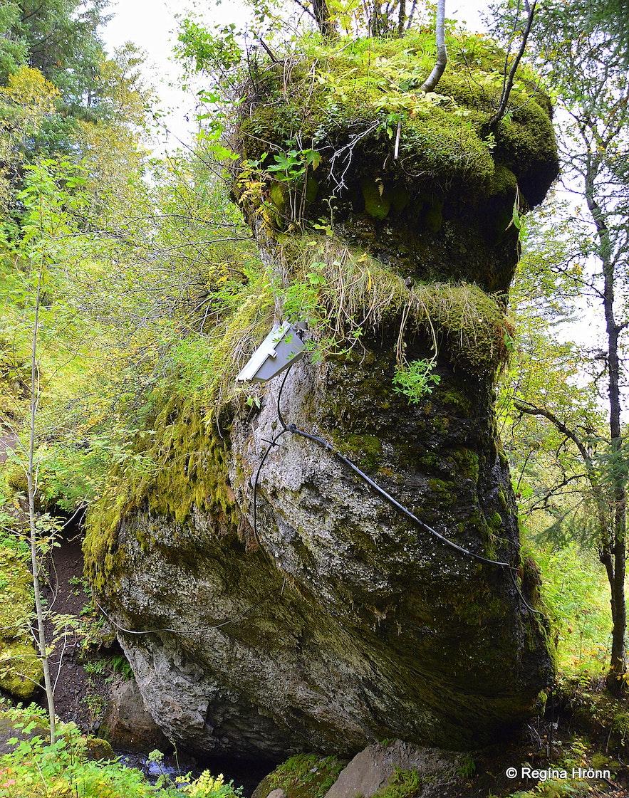 Fossasteinn Rock by Systrafoss waterfall