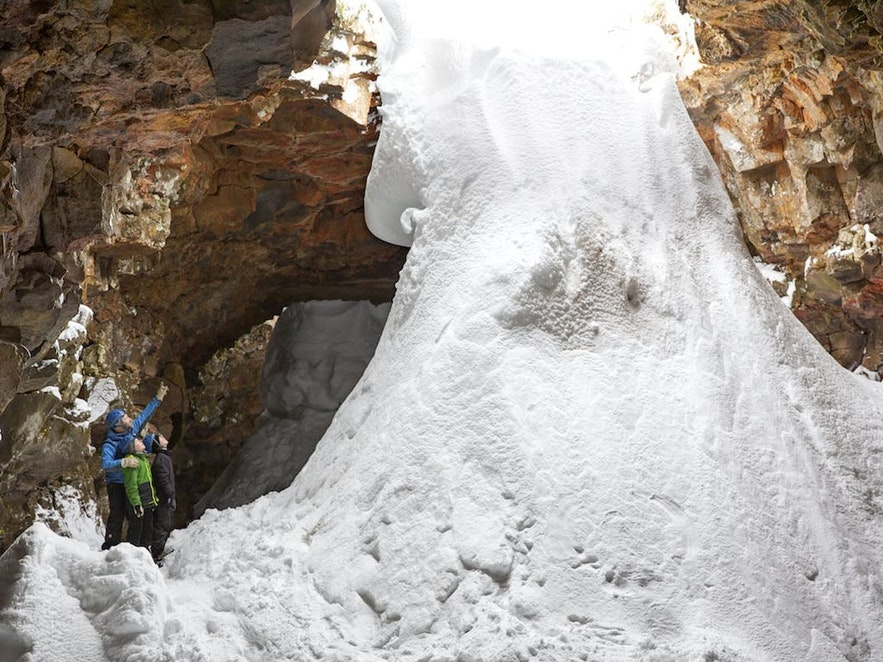 Snow pouring into a icy lava cave
