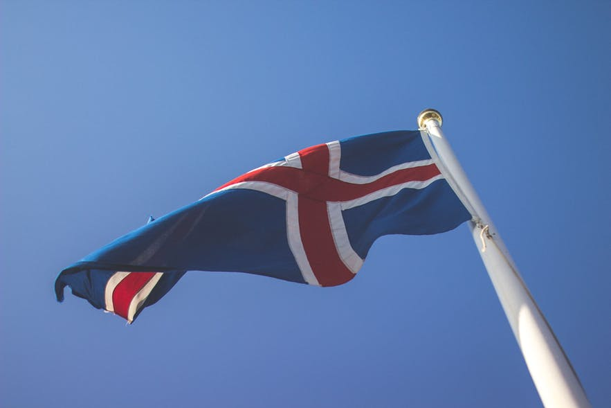 The Icelandic flag waving in defiance against Danish rule.