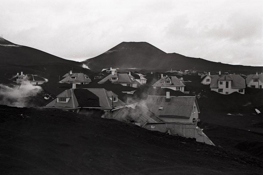 The island of Heimaey, mid-eruption.