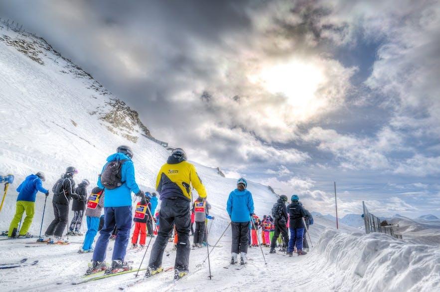 Skiers queue at Blafjoll ski resort.