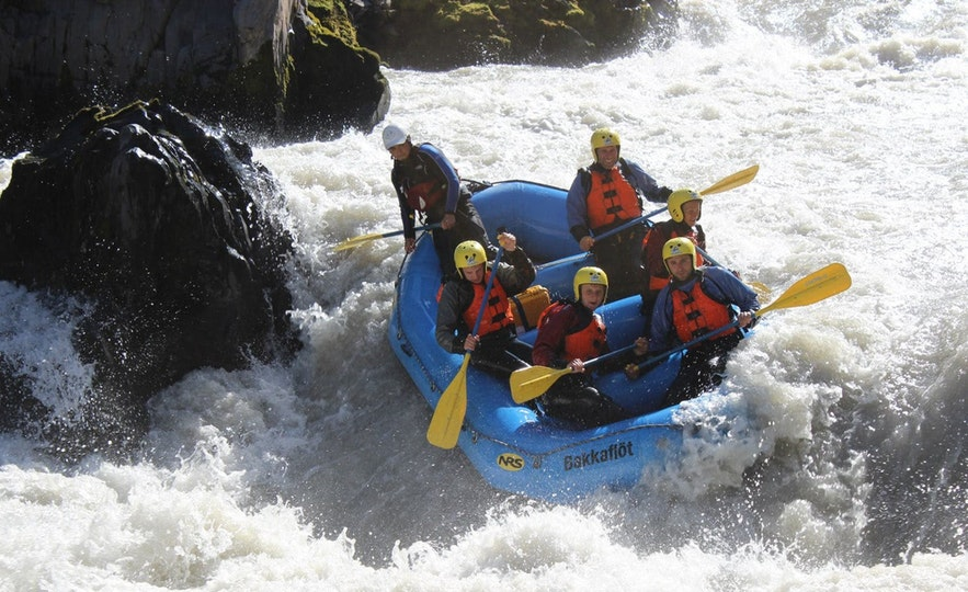 A river nearly flips a boat of rafters in Iceland.