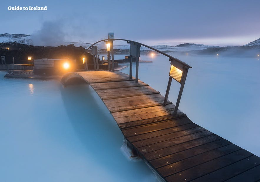 A bridge crosses the azure waters of the Blue Lagoon.