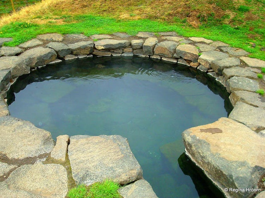 A small pool in Iceland, perfect for geothermal bathing.