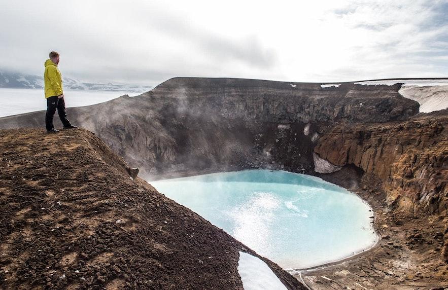 Bathing in the hot spring Víti in Askja, Iceland