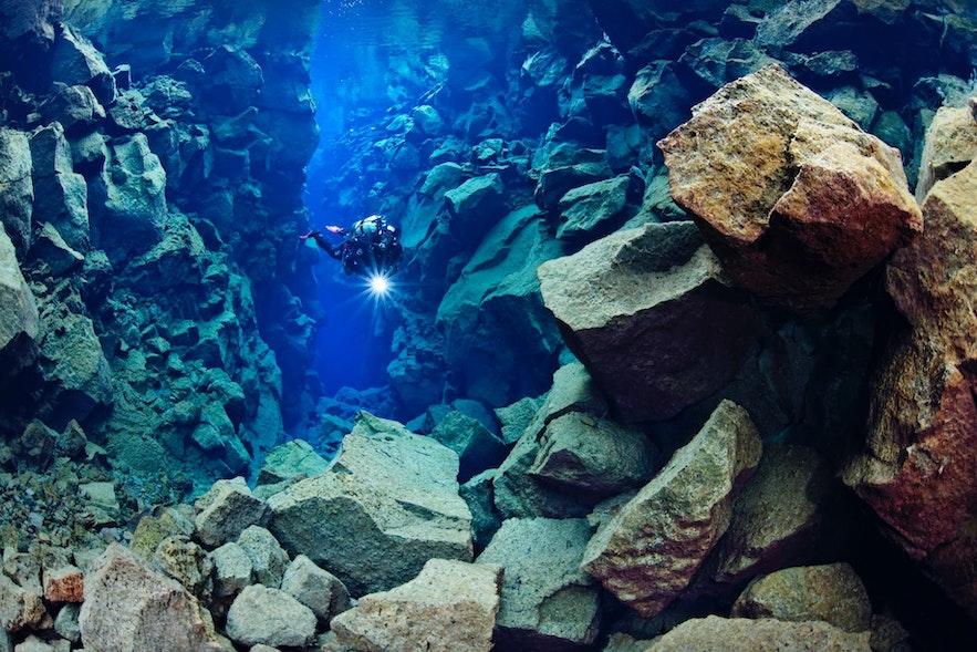 Diving in Silfra fissure in Iceland.