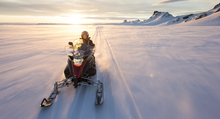 Snowmobiling is a glacier-based adventure in Iceland.