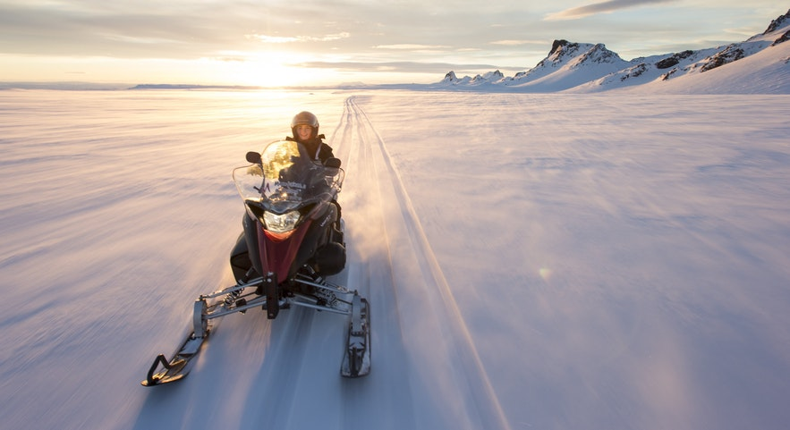 Snowmobiling on top of Langjokull glacier in Iceland