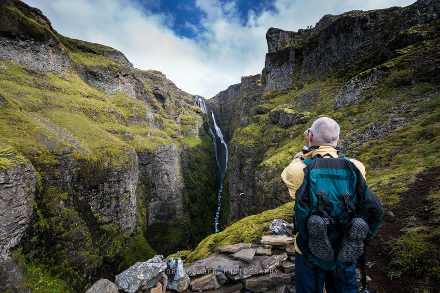 The lush Glymur waterfall in Iceland
