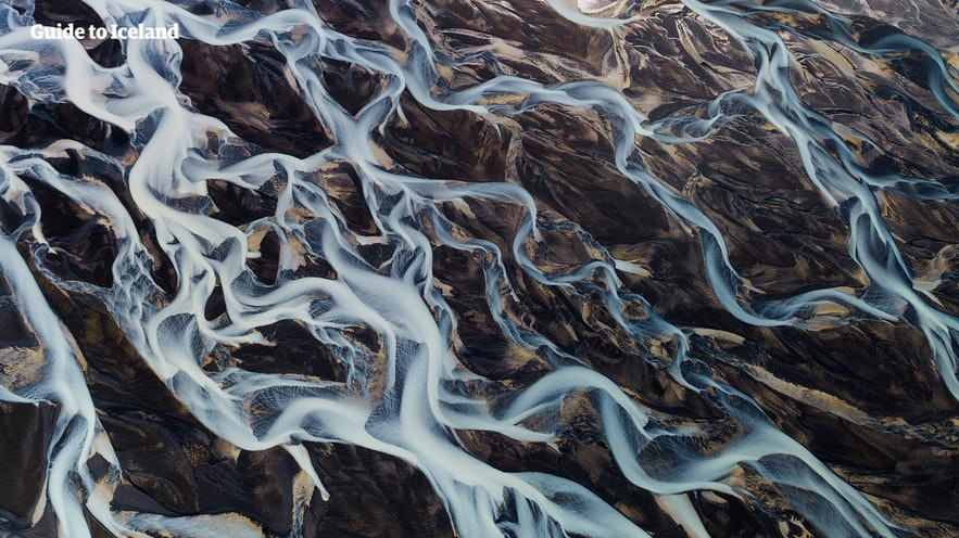 A river network snakes through Iceland, as seen from a helicopter.