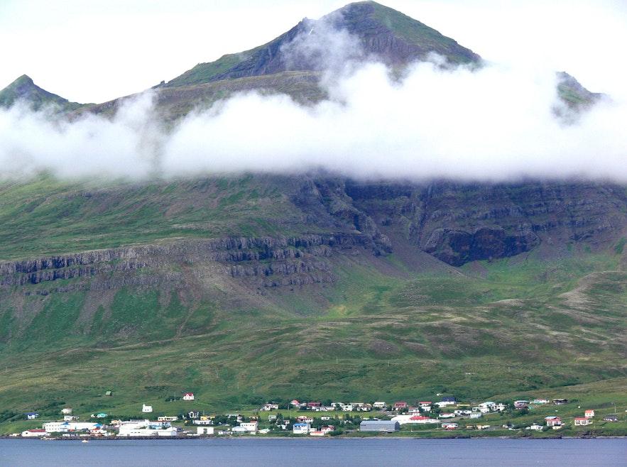 Stöðvarfjördur sits beneath a cloud in East Iceland.