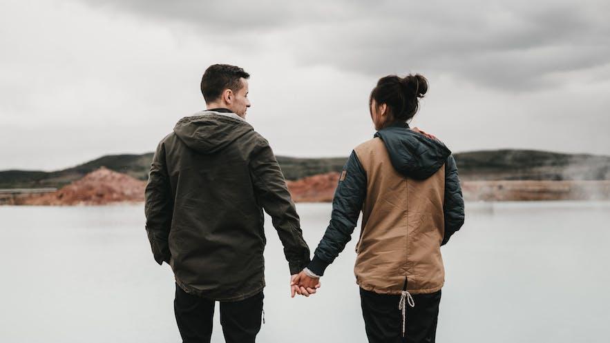 Honeymooners walk beside the Blue Lagoon.