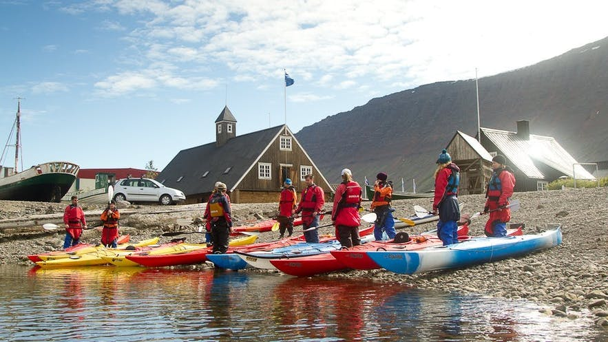 Kayakers prepare to embark on an adventure in Iceland.