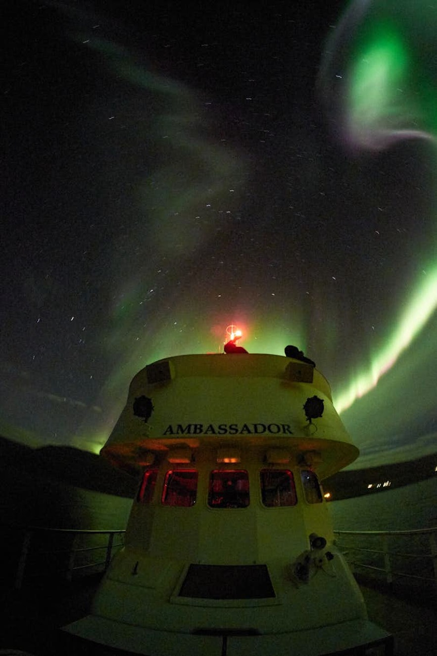 Boats allow you to see the auroras from a stunning vantage point.