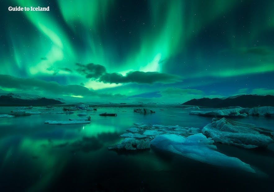 The vivid colours of the Northern Lights dance over Jokulsarlon.