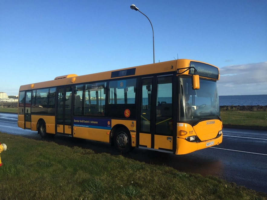 A bus pulls up on Saebraut in Iceland.