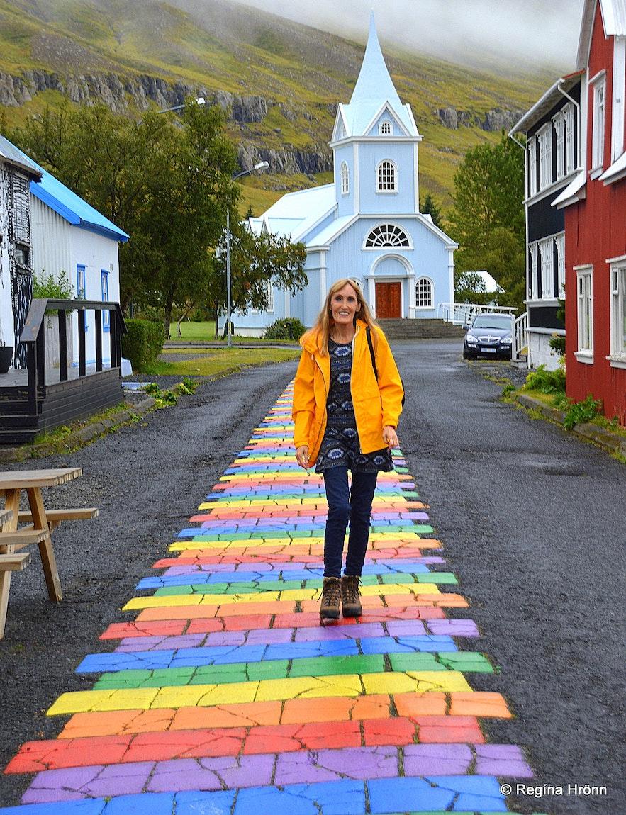 Regína on The rainbow street in Seyðisfjörður and the blue church