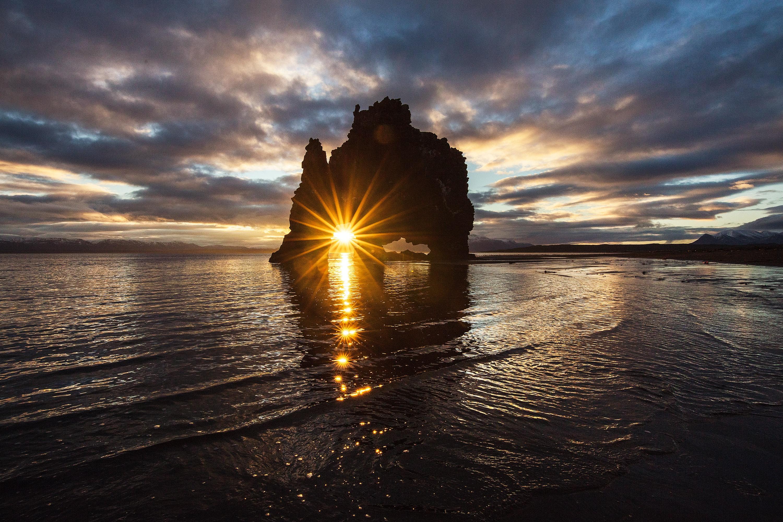 The sun gleams through Hvitserkur.
