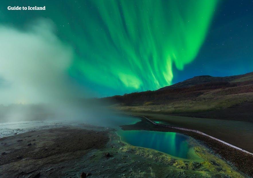 Hot springs bubble invitingly under the aurora borealis.