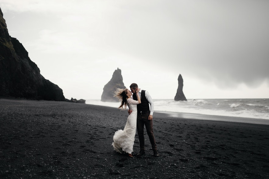A couple get married on Reynisfjara beach.
