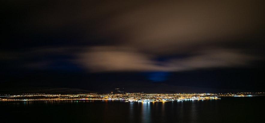 Akureyri by night, from the ocean.