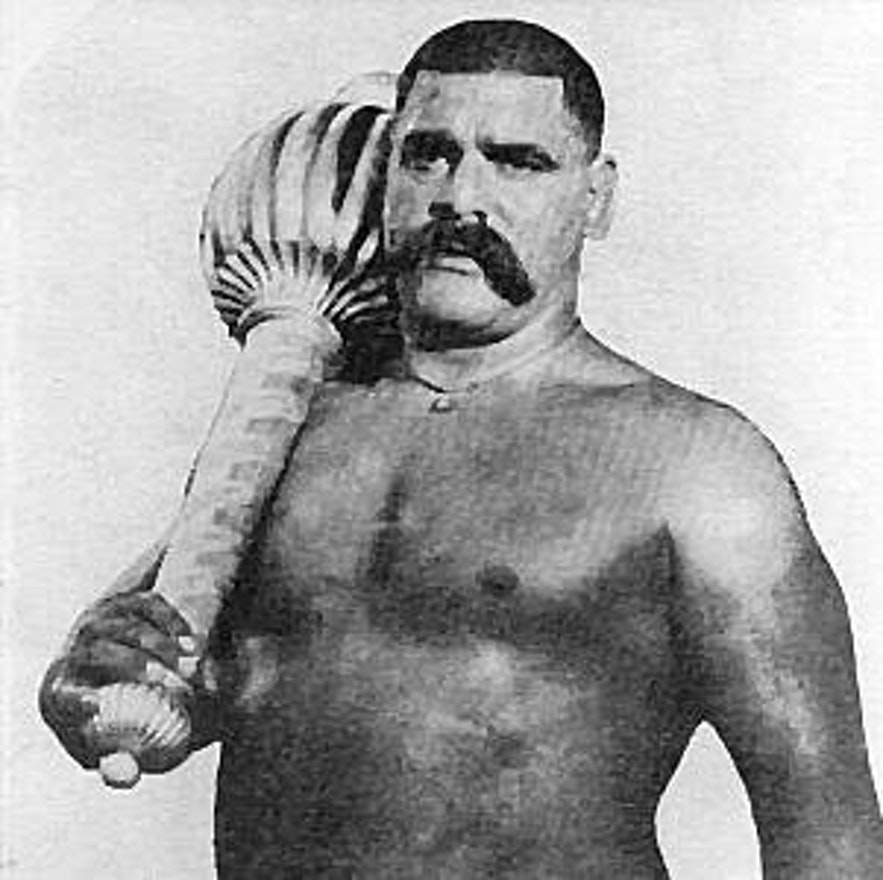 An old fashioned strongman.