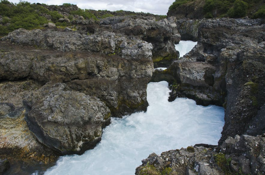 Barnafoss is a surging waterfall in Iceland's west.