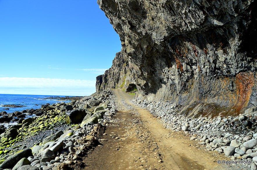 The road by Skútabjörg cliffs in the Westfjords