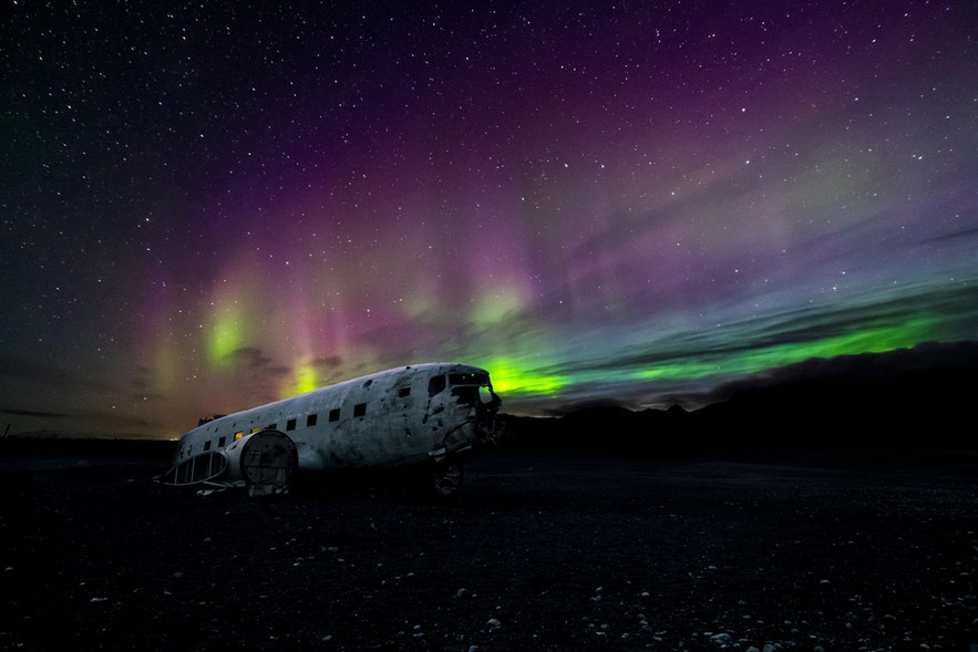 The DC-3 wreck under the Northern Lights.