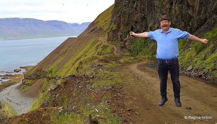 Regína's husband jumping on Kjaranbraut road in the Westfjords
