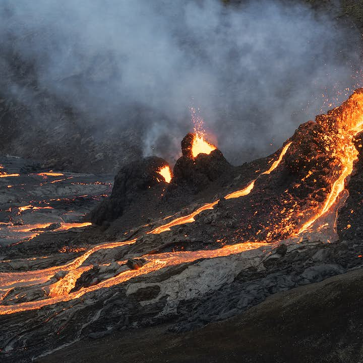 A river of lava spills from a crater at the Fagradalsfjall volcano.