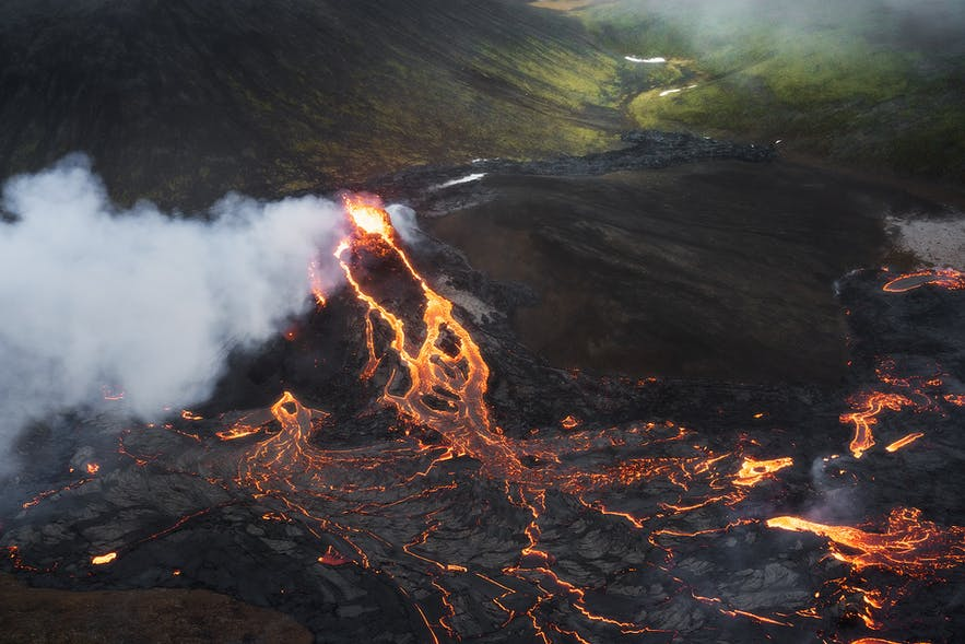 A river of lava flows from a crater at Fagradalsfjall volcano in Iceland.