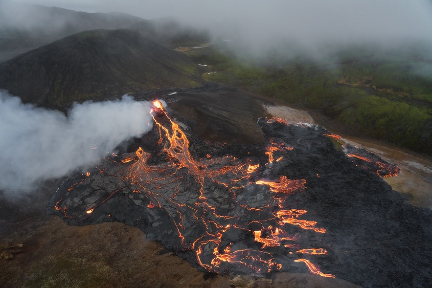 An overhead shot of the glowing lava field of Fagradalsfjall during its 2021 eruption.