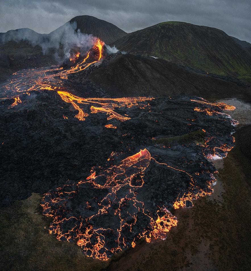 Cracks of red break the black lava at Fagradalsfjall.