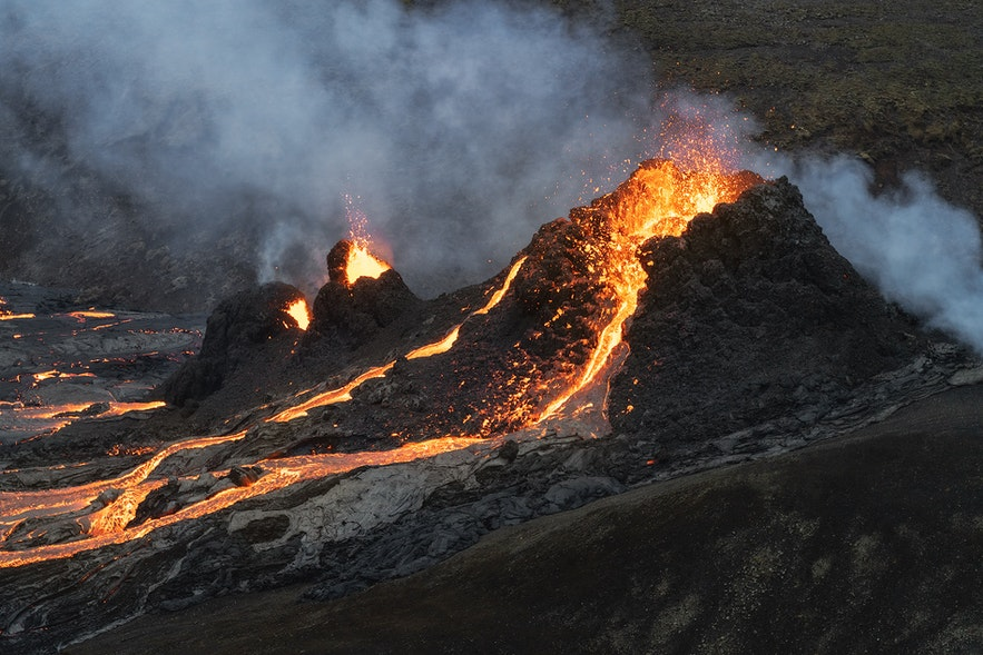 Lava sputters from a crater in a close-up image of Fagradalsfjall.