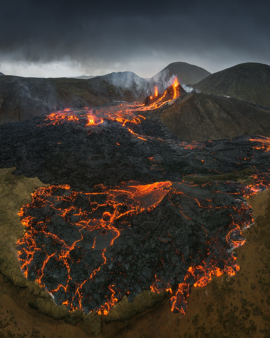 Two jets of fire rise over the lava landscapes of the erupting Fagradalsfjall.