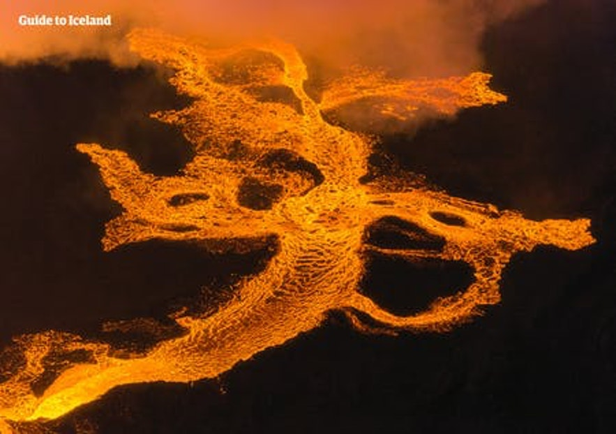 Holuhraun's rivers of lava gleam a vivid orange.