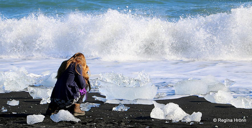 Regína photographing the ice diamonds on the ice diamond beach