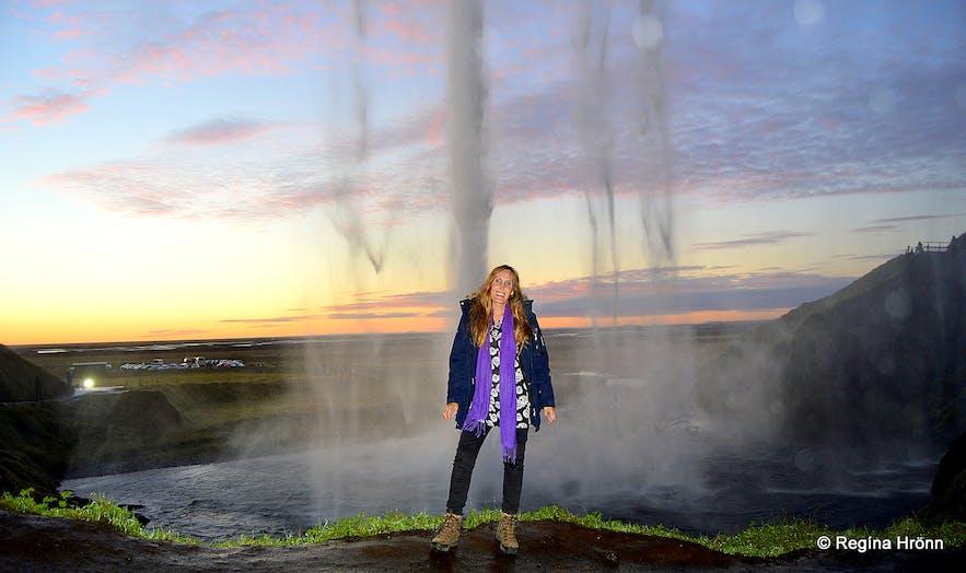 Regína behind Seljalandsfoss waterfall