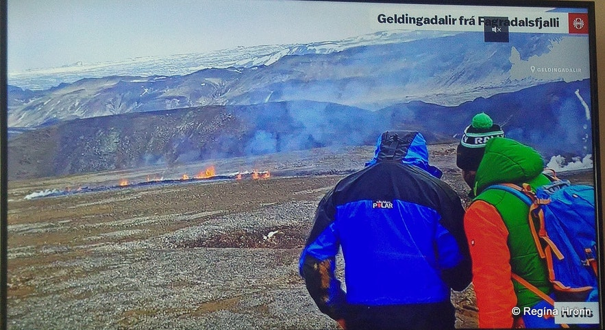 People blocking the view of the volcano on the live camera
