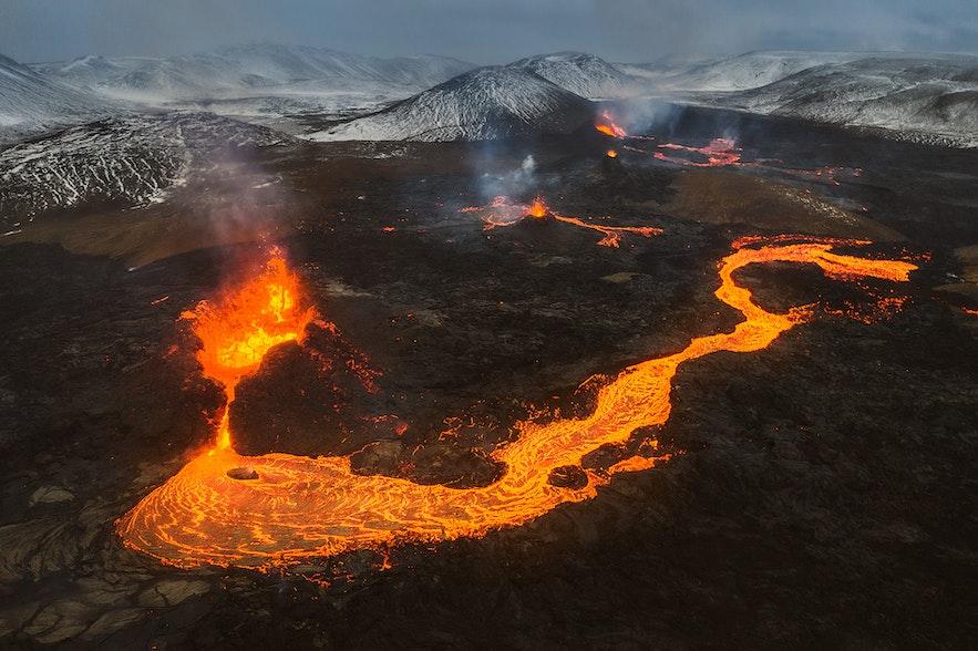 Gleaming lava bursts from Geldingadalur volcano.