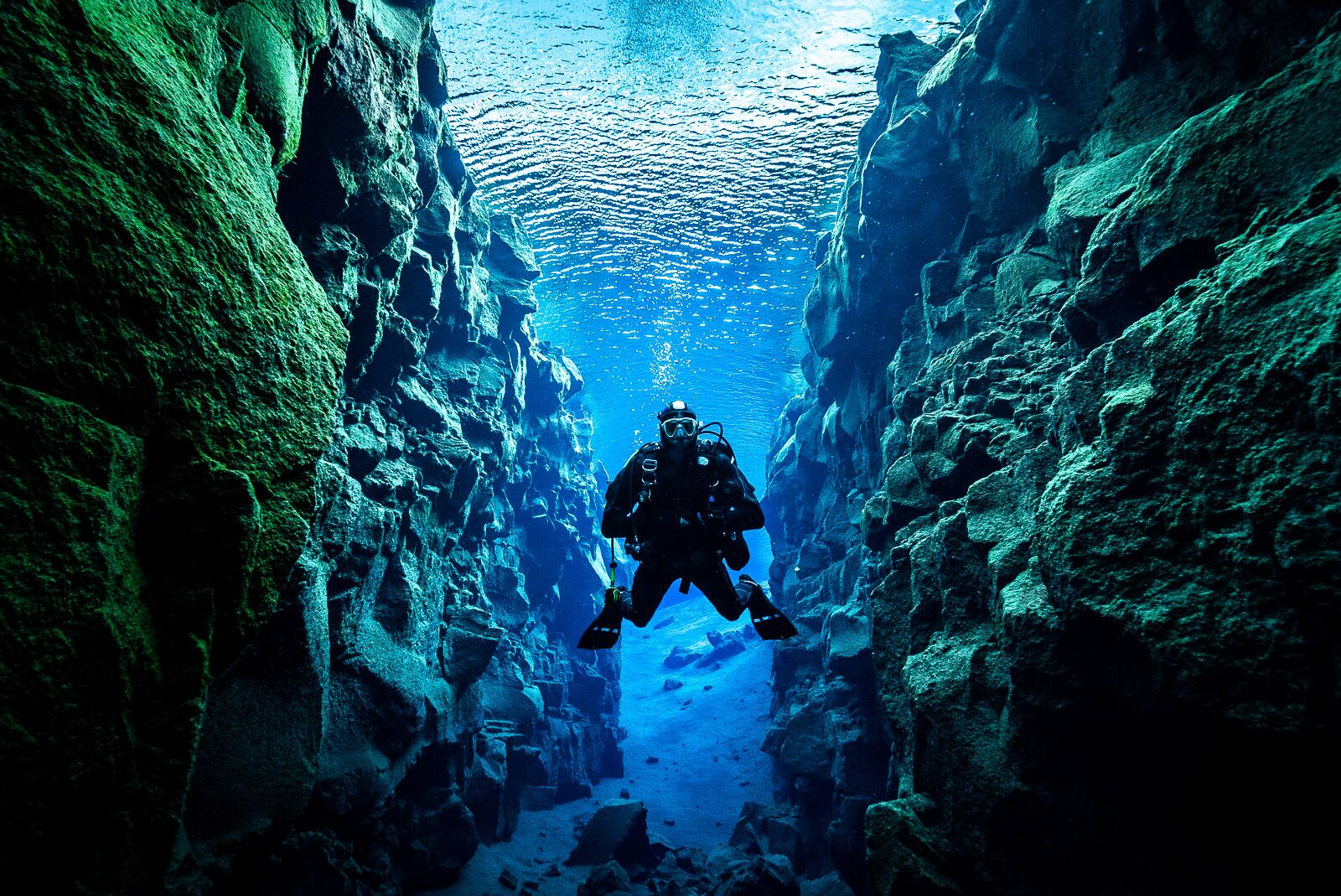 A diver in Silfra fissure in Iceland.