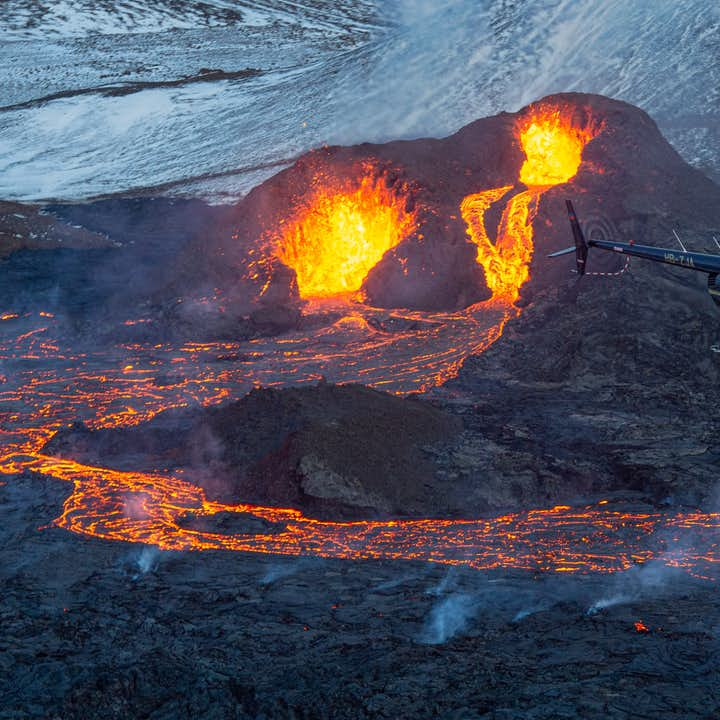 A helicopter soars over Iceland's ongoing eruption.