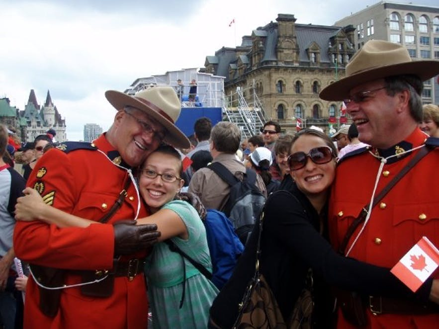 being a good Canadian and hugging a mountie in Ottawa on Canada day